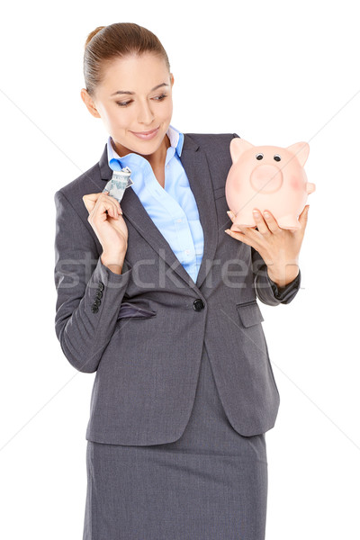 Woman deciding whether to spend or save Stock photo © dash