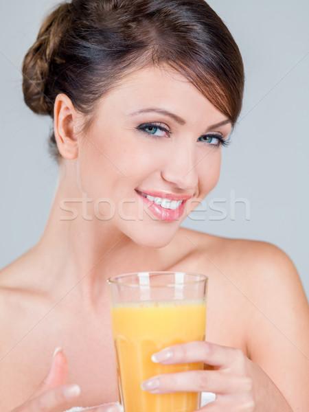 Donna sorridente vetro succo d'arancia ritratto sorridere Foto d'archivio © dash