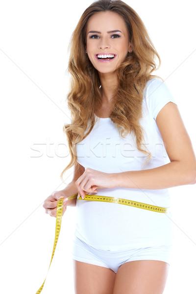 Kobieta w ciąży talia centymetrem szczęśliwy Zdjęcia stock © dash