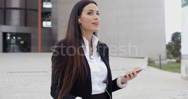 Young woman listening to a mobile call Stock photo © dash