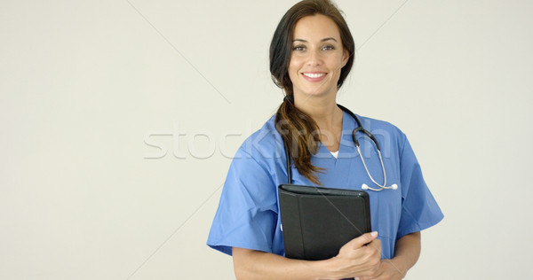 Smiling young female physician smiles at camera Stock photo © dash