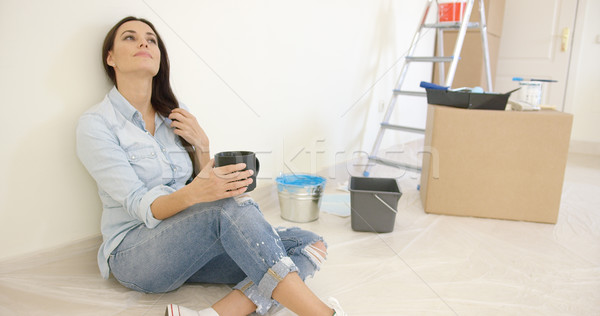 Pretty young woman relaxing while renovating Stock photo © dash