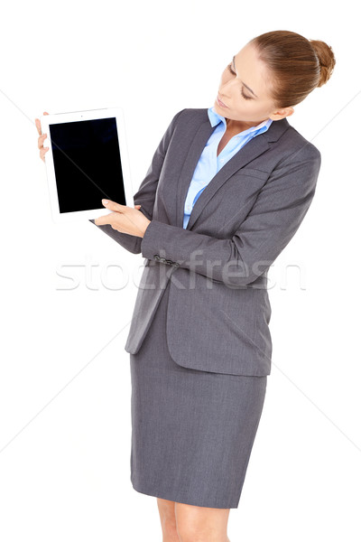 Businesswoman displaying her tablet Stock photo © dash