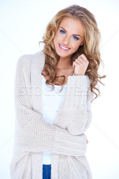 Sorridente loiro mulher suéter cardigã Foto stock © dash