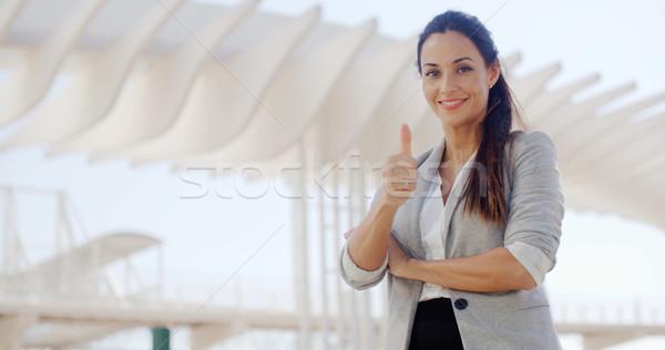 Motivado jóvenes mujer de negocios gesto Foto stock © dash