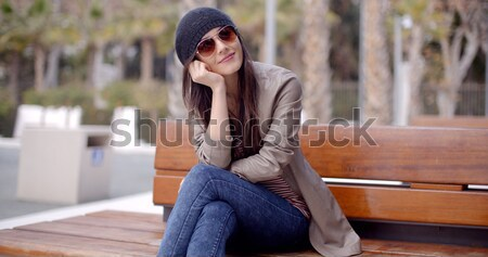 Trendy casual woman relaxing in a park Stock photo © dash