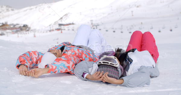 Two skiers laying on the ground Stock photo © dash