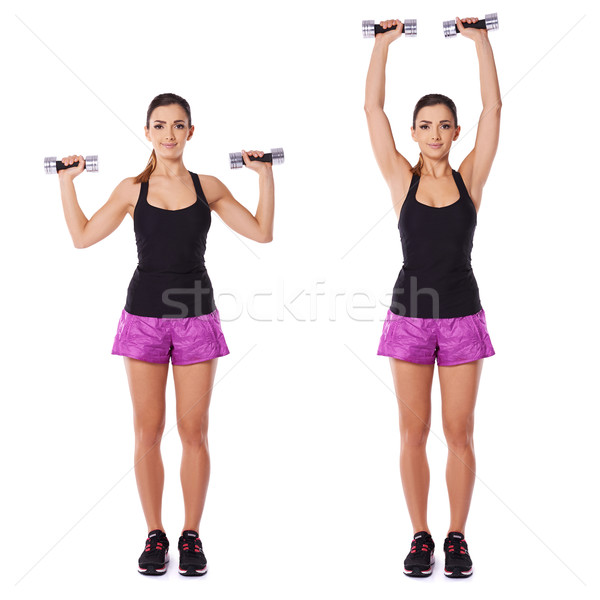 Stock photo: Woman working out with dumbbells in a gym