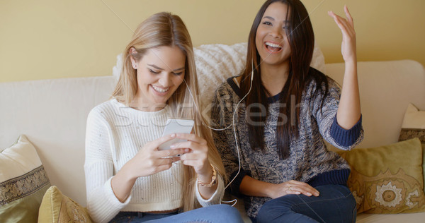 Happy young women cheering at good news Stock photo © dash