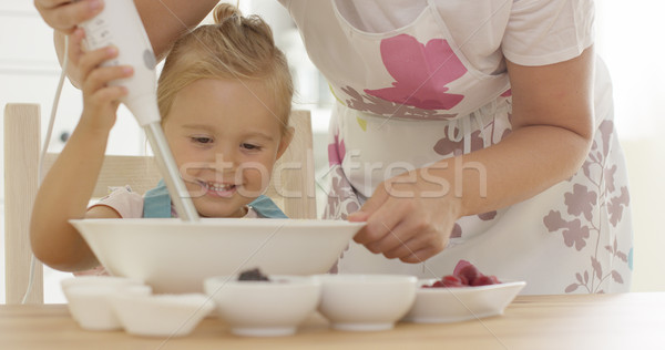 Cute happy little girl helping with the baking Stock photo © dash