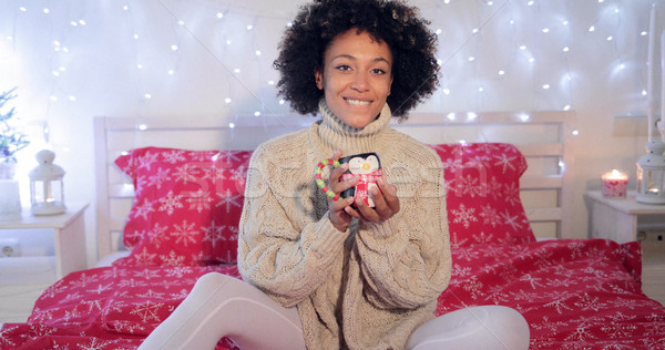 Pretty y woman admiring her Christmas coffee cup Stock photo © dash