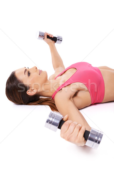 Woman working out using dumbbells Stock photo © dash