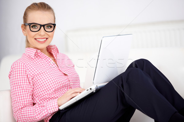 Pretty woman wearing glasses relaxing at home Stock photo © dash
