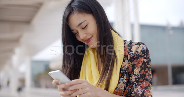 Chic young woman checking her text messages Stock photo © dash