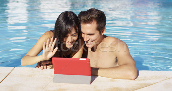 Couple communicates with friends on digital device Stock photo © dash