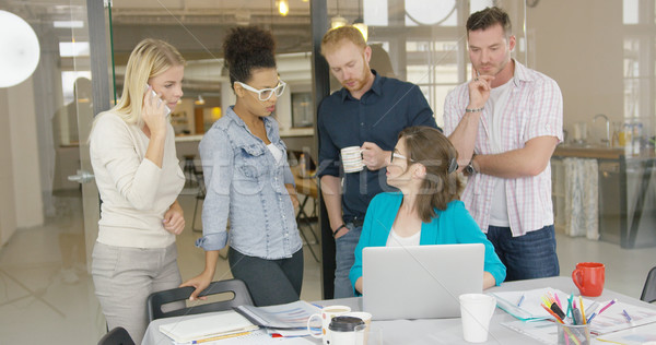 Coworkers watching laptop Stock photo © dash