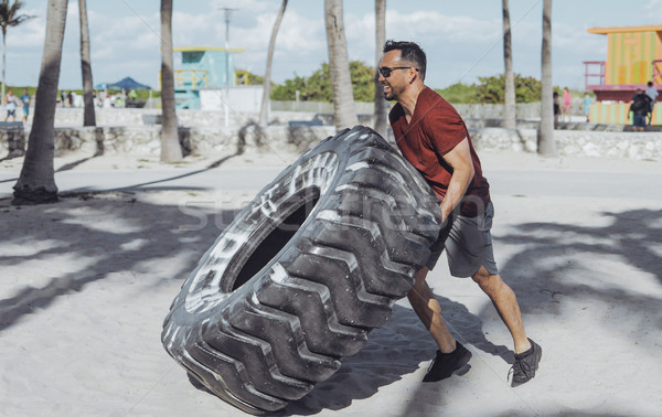 Man working out with tyre Stock photo © dash