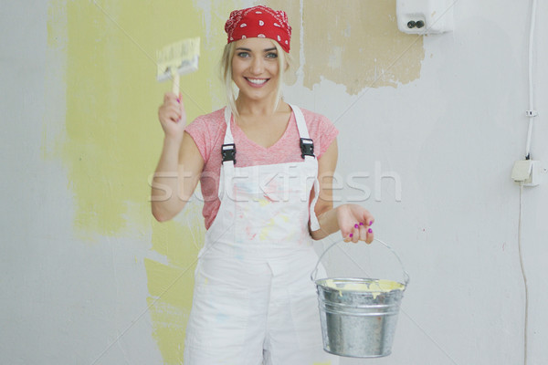 Delighted woman with brush and paint bucket  Stock photo © dash