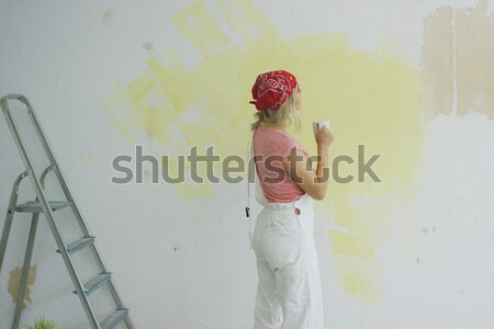 Painting wall woman talking on smartphone  Stock photo © dash