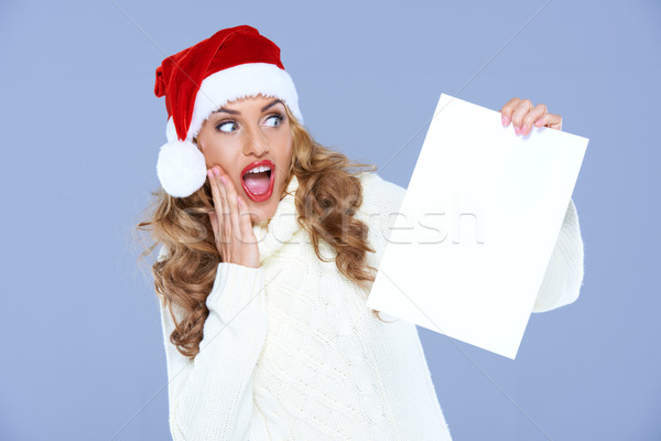 Blond woman in Santa Hat is in hudge shock Stock photo © dash
