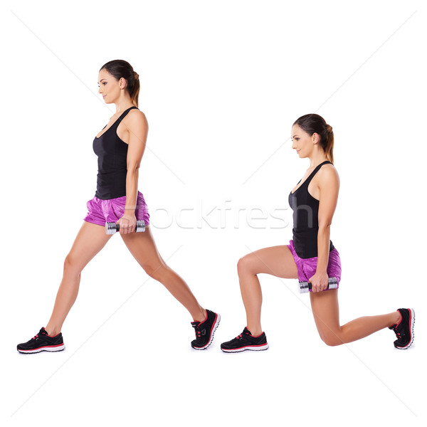 Stock photo: Athletic woman working with dumbbells