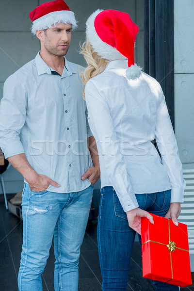 Young woman surprising her husband at Xmas Stock photo © dash