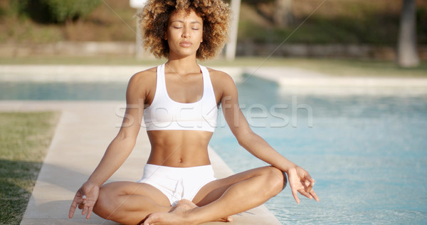 Healthy Woman Meditating Near The Pool Stock photo © dash