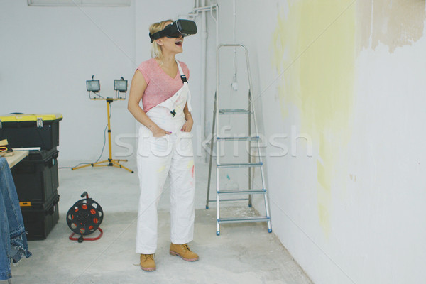 Excited female painter in virtual reality goggles  Stock photo © dash