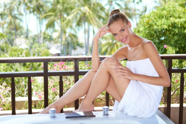 Woman in towel on bathtub Stock photo © dash