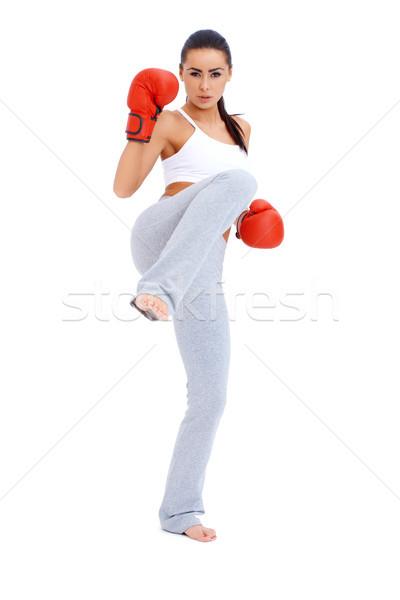 Egészalakos lövés női rúgás boxoló fehér Stock fotó © dash