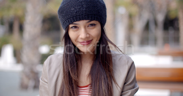 Pretty thoughtful young woman in a woolly cap Stock photo © dash