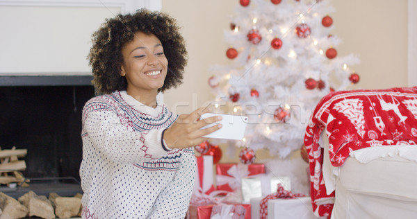 Happy young woman posing for a Christmas selfie Stock photo © dash