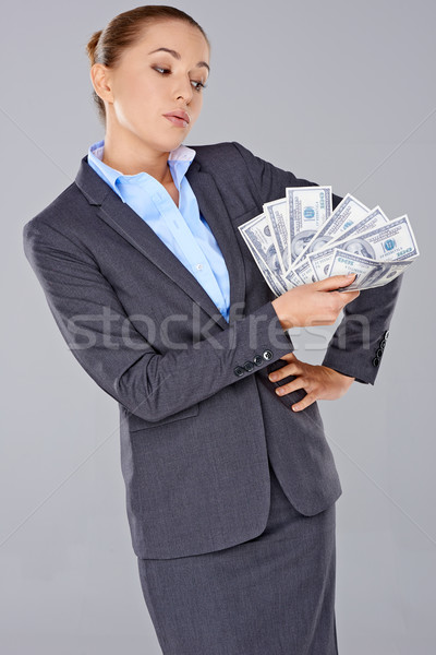 Successful businesswoman with a wad of money Stock photo © dash