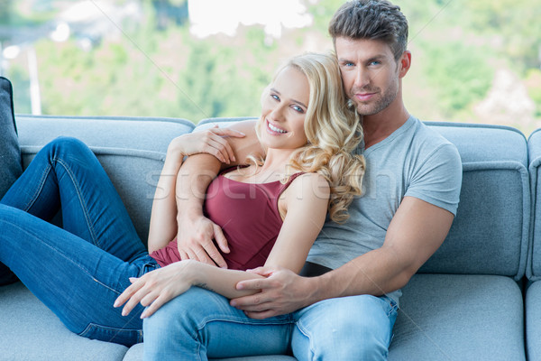 Young couple relaxing on a sofa together Stock photo © dash