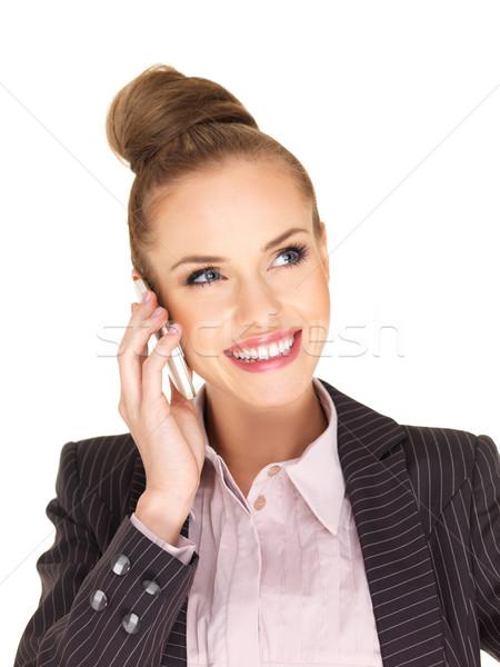 Elegant woman talking on her mobile phone Stock photo © dash