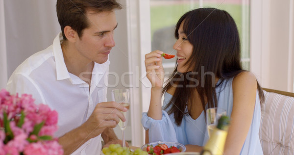 Couple sipping wine and eating fruit Stock photo © dash