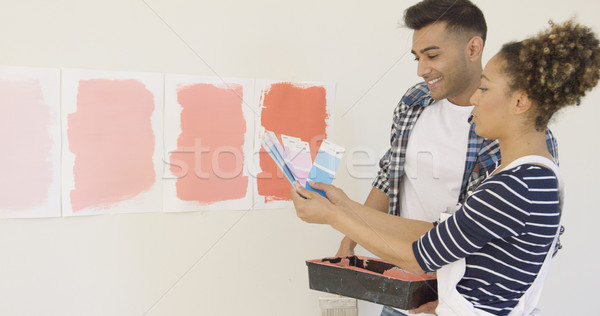 Young couple checking paint swatches Stock photo © dash