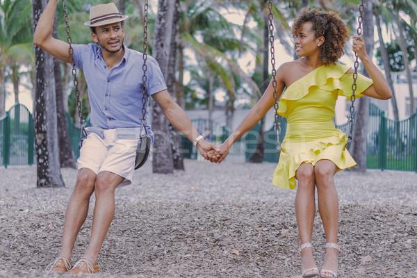 Сток-фото: пару · , · держась · за · руки · Swing · взрослый · этнических · красивый