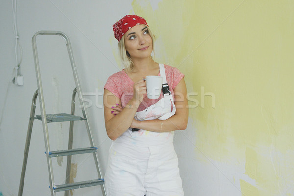 Smiling woman painter standing with drink Stock photo © dash