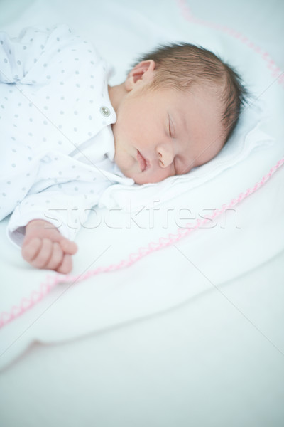 Close up of Sleeping Baby on White Bed Stock photo © dash