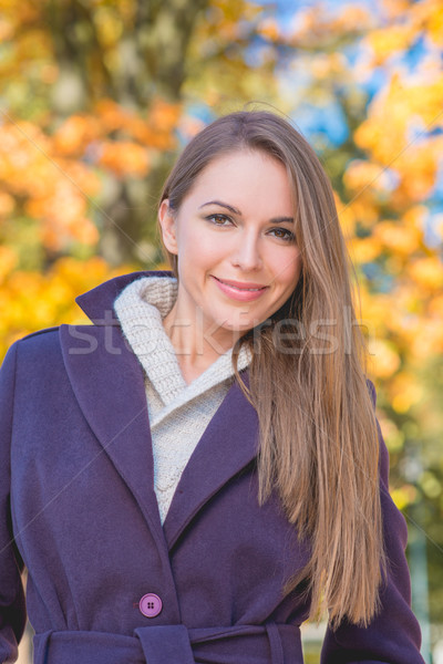 Attractive woman with a beaming smile Stock photo © dash