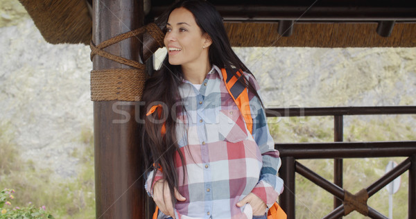 Young female hiker relaxing at a mountain lookout Stock photo © dash