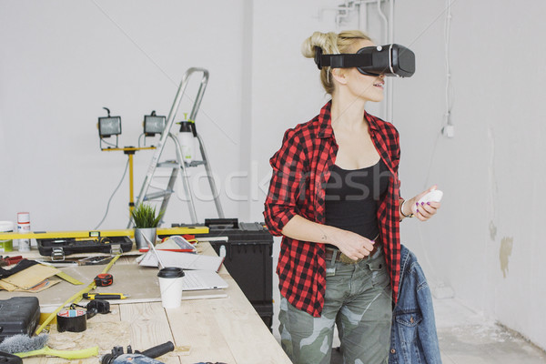 Female in virtual reality headset in workshop  Stock photo © dash