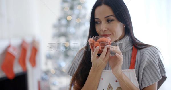 Pretty young woman enjoying her Christmas baking Stock photo © dash