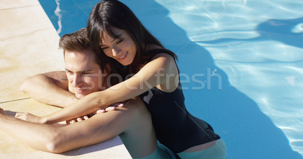 Woman in black swim suit hugs her boyfriend Stock photo © dash