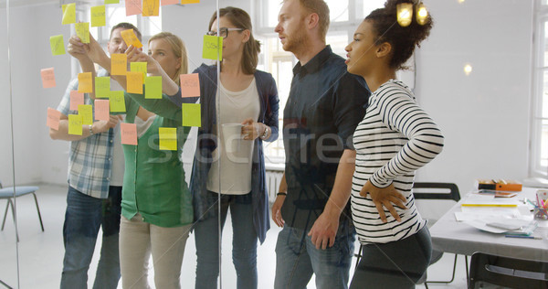 Young people working together in office Stock photo © dash