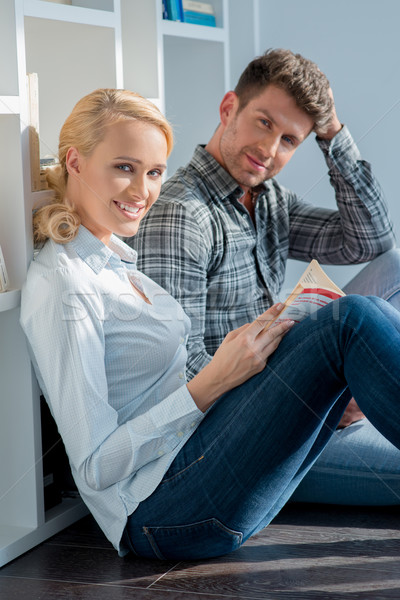 Middle Age Couple Sitting on Floor Looking at Cam Stock photo © dash
