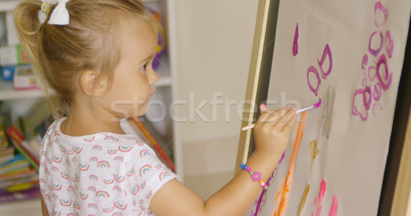 Creative little girl painting in a playroom Stock photo © dash