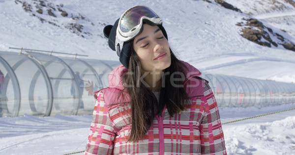 Young woman relaxing on ski slope in winter Stock photo © dash