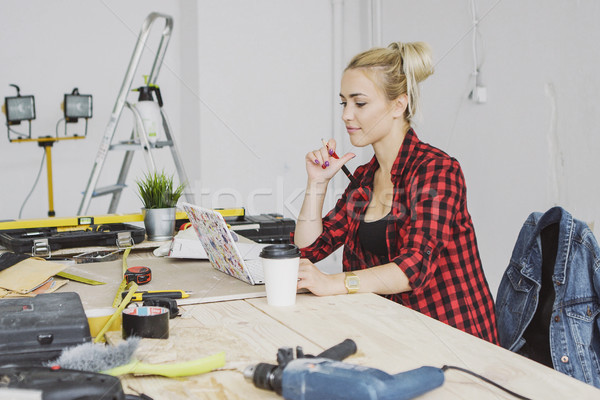 Stock photo: Sitting at workbench female using laptop